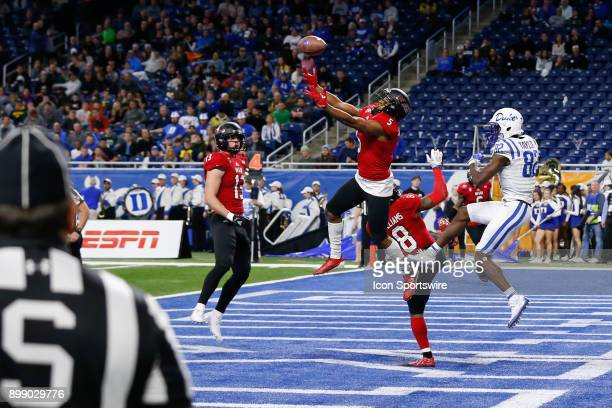 Northern Illinois Huskies corner back Mayomi Olootu Jr breaks up a pass in the end zone during the Quick Lane Bowl game between the Duke Blue Devils...