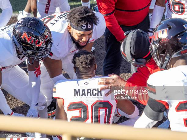 Northern Illinois Huskies cornerback Zhamaine March gets congratulated by his teammates during the college football game between the Northern...