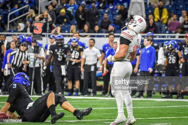 Northern Illinois Huskies defensive end Sutton Smith celebrates his sack of Buffalo Bulls quarterback Tyree Jackson during the Northern Illinois...