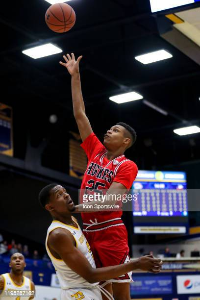 Northern Illinois Huskies forward Nathan Scott shoots over Kent State Golden Flashes forward Danny Pippen during the first half of the men's college...