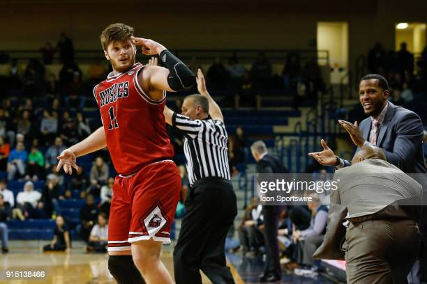 Northern Illinois Huskies forward Noah McCarty salutes his teammates on the bench after hitting a threepoint shot during the second half of a regular...