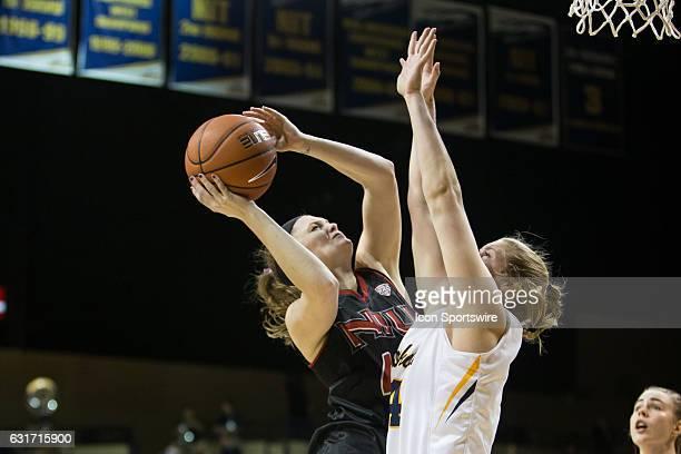 Northern Illinois Huskies guard Courtney Woods shoots over Toledo Rockets forward Michaela Rasmussen during a regular season basketball game between...
