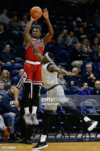 Northern Illinois Huskies guard Eugene German shoots a jump shot over Toledo Rockets guard Marreon Jackson during the second half of a regular season...