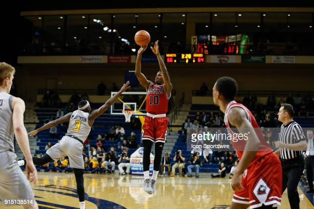 Northern Illinois Huskies guard Eugene German shoots a jump shot during the second half of a regular season MidAmerican Conference game between the...