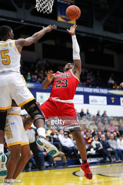 Northern Illinois Huskies guard Tyler Cochran shoots as Kent State Golden Flashes forward Danny Pippen defends during the first half of the men's...