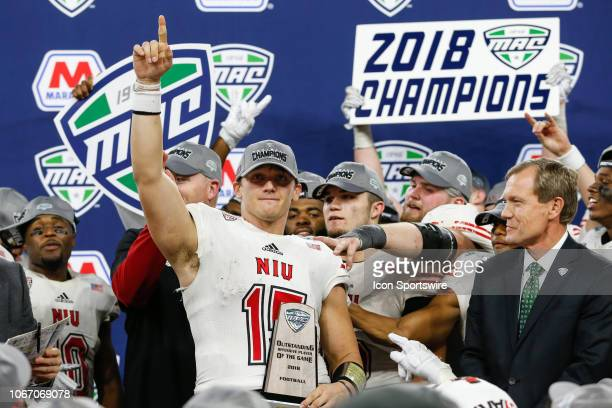 Northern Illinois Huskies quarterback Marcus Childers celebrates after being named the Most Outstanding Offensive Player of the Game during the...