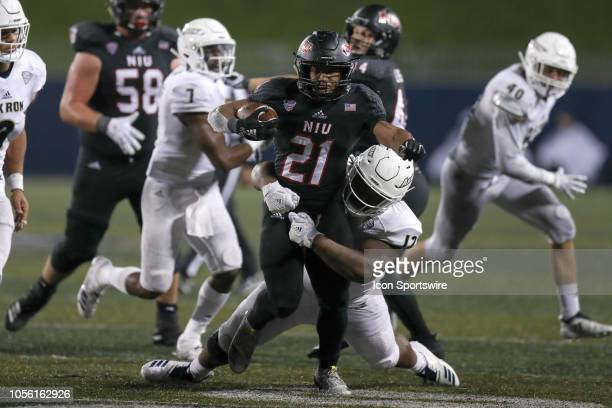 Northern Illinois Huskies tailback Marcus Jones is tackled by Akron Zips defensive lineman DeAndre Brimage during the fourth quarter of the college...