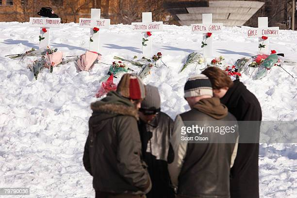 Northern Illinois University students gather for a prayer circle in front of a memorial to slain students constructed near Cole Hall on the campus of...
