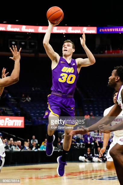 Northern Iowa Panthers guard Spencer Haldeman goes in for a shot as the shot clock expires during the second half of an MVC Tournament basketball...
