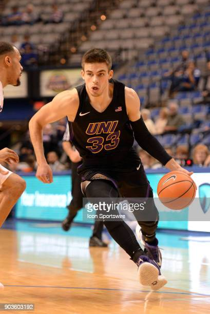 Northern Iowa Panthers Guard Wyatt Lohaus dribbles toward the basket during the Missouri Valley Conference college basketball game between the...