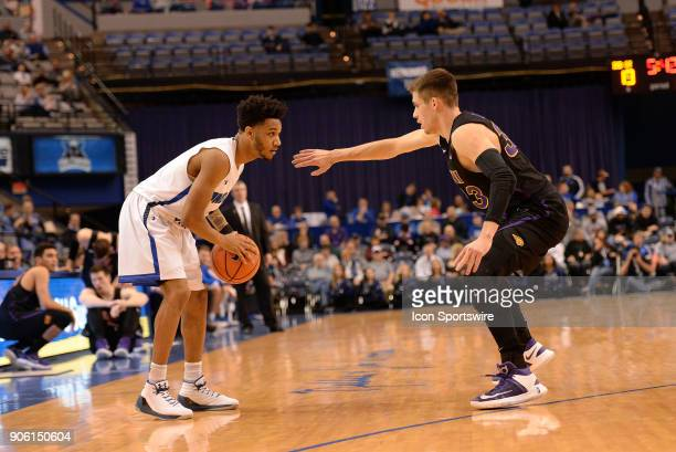 Northern Iowa Panthers Guard Wyatt Lohaus guards Indiana State Sycamores Guard Jordan Barnes on the perimeter of the three point line during the...
