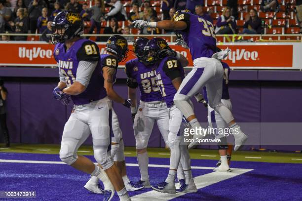 Northern Iowa Panthers wide receiver Jalen Rima is swarmed by teammates including Northern Iowa Panthers running back Tyler Hoosman after scoring a...
