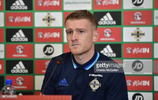 Northern Ireland captain Steve Davis talks to the media at a player manager press conference at Windsor Park on October 4 2017 in Belfast Northern...