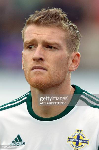 Northern Ireland captain Steven Davis listens to his national anthem prior to the UEFA Euro 2016 Group F qualifying football match of Hungary vs...