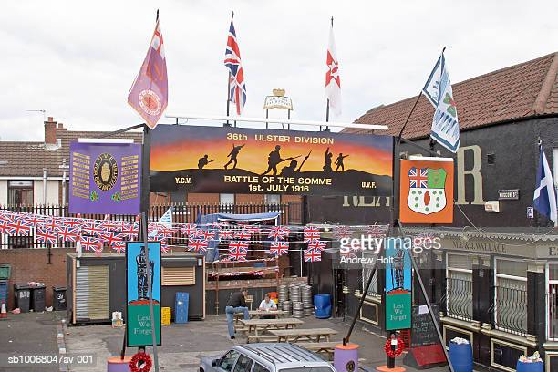 uk, northern ireland, city of belfast, union jack flags, logos, battle of the somme murals, signs and graffiti on shankill road - andrew jack stock pictures, royalty-free photos & images
