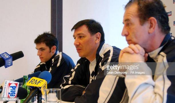 Northern Ireland coach Lawrie Sanchez assistant coach Gerry Armstrong and player Aaron Hughes talk to the media