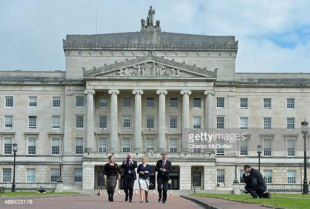 Northern Ireland Deputy First Minister Martin McGuinness and Sinn Fein President Gerry Adams take photographs with their smartphones of the gathered...