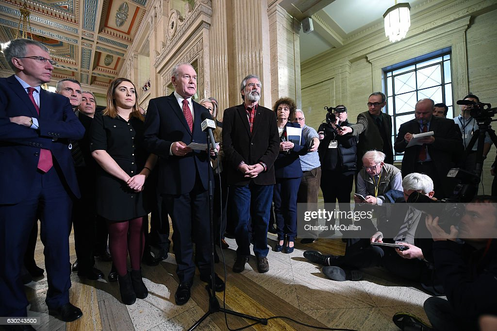 Northern Ireland Deputy First Minister Martin McGuinness (C) and Sinn Fein President Gerry Adams address the media regards the RHI crisis at Stormont on December 19, 2016 in Belfast, Northern Ireland. First Minister Foster is facing a vote of no confidence over the Renewable Heating Incentive (RHI) scheme. Set up in November 2012, the Renewable Heat Incentive scheme was an attempt by the Northern Ireland Executive to help to increase consumption of heat from renewable sources. The DETI minister at the time was the now First Minister, Arlene Foster. A whistleblower has since highlighted a loophole that will result in a cost of £485 million pounds because of a flaw in the scheme.