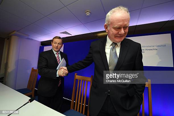 Northern Ireland Deputy First Minister Martin McGuinness shakes hands with Irish Taoiseach Enda Kenny after holding a press conference at the North...