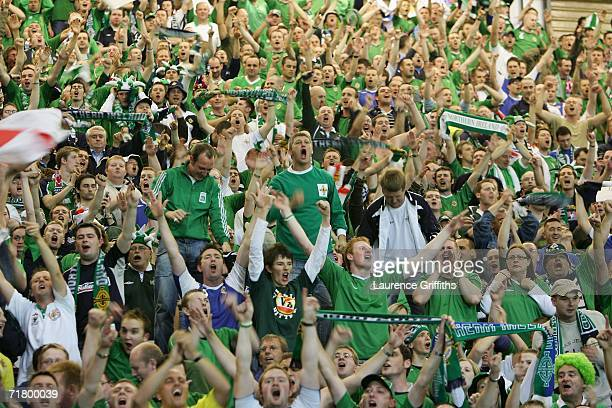Northern Ireland fans celebrate after victory against Spain in the Euro 2008 Qualifying Group F Match at Windsor Park September 6 2006 in Belfast...