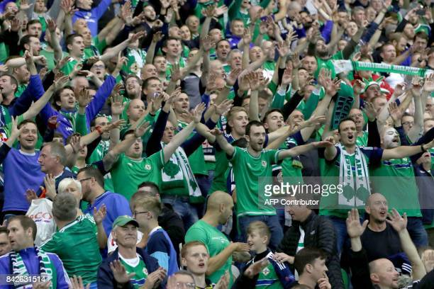 Northern Ireland fans celebrate during injury time of the World Cup 2018 qualification football match between Northern Ireland and Czech Republic at...