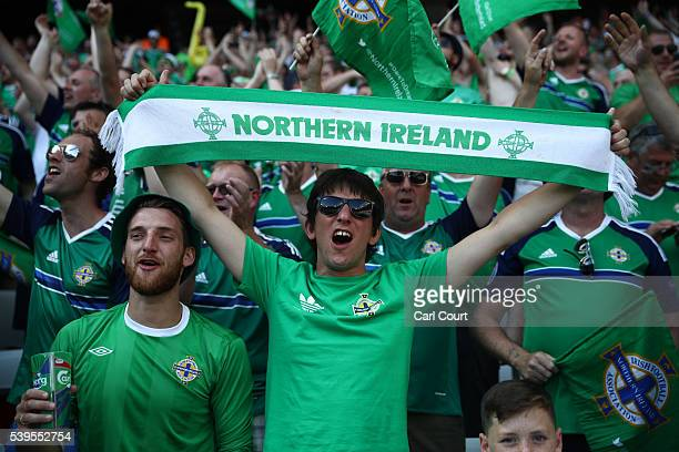 Northern Ireland fans cheer as they wait for Northern Ireland to play Poland in the group stage of the UEFA Euro 2016 football tournament at Allianz...