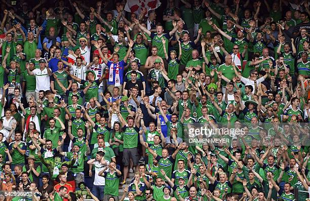 Northern Ireland fans cheer during the Euro 2016 round of sixteen football match Wales vs Northern Ireland on June 25 2016 at the Parc des Princes...