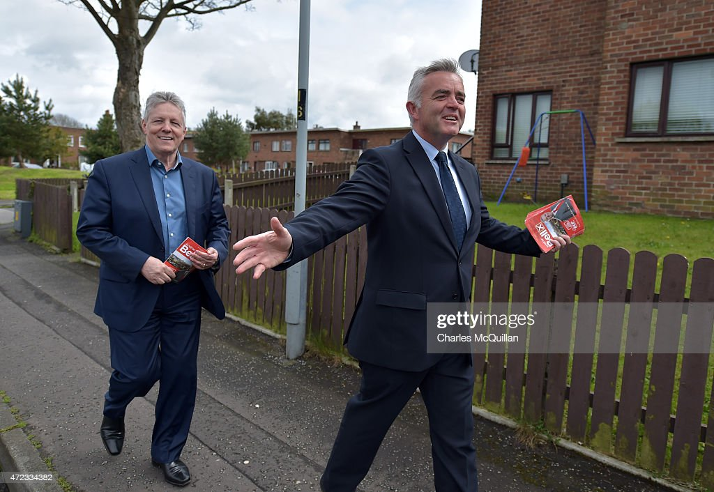 Northern Ireland First Minister and DUP leader Peter Robinson (L) out canvassing in support of DUP south Belfast candidate Jonathan Bell (R) on May 6, 2015 in Belfast, Northern Ireland. Many political observers have predicted that the expected 8-10 DUP Westminster seats could have a key role in deciding who will form the next government if the general election results in a hung parliment. In anticipation of the important role the party may play the DUP has already outlined their demands from a potential government partner and hasn't ruled out working with Labour or the Conservatives.