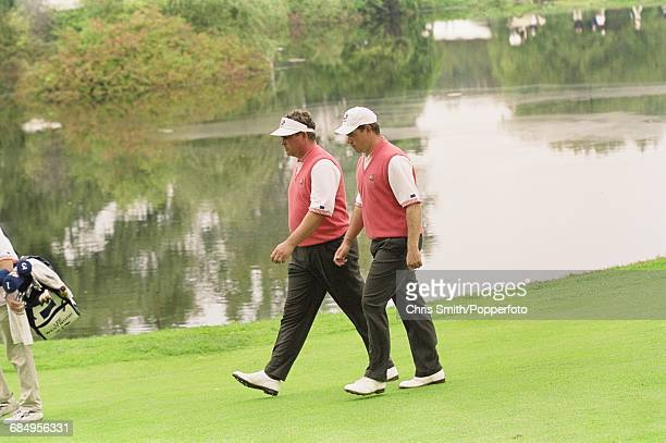Northern Ireland golfer Darren Clarke and his partner English golfer Lee Westwood pictured together in competition for Team Europe during play to...