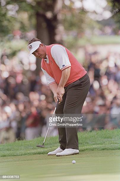Northern Ireland golfer Darren Clarke pictured in action putting on a green for Team Europe during play to lose to Team USA in the 1999 Ryder Cup 145...