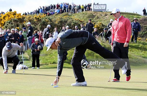 Northern Ireland golfer Rory McIlroy and US golfer Rickie Fowler are pictured as they play on the first day of the Irish Open at the Royal County...