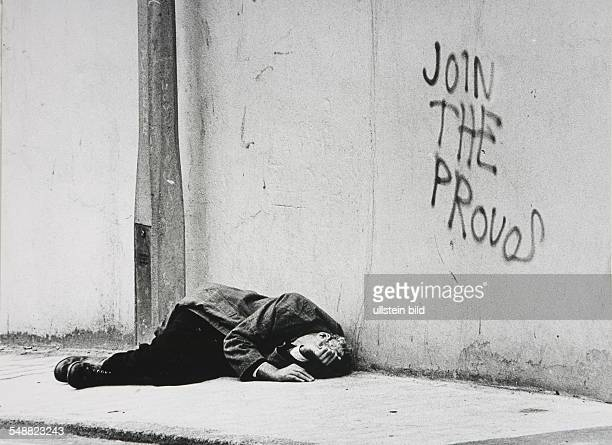 GBR Northern Ireland Londonderry A drunk man sleeps on the pavement