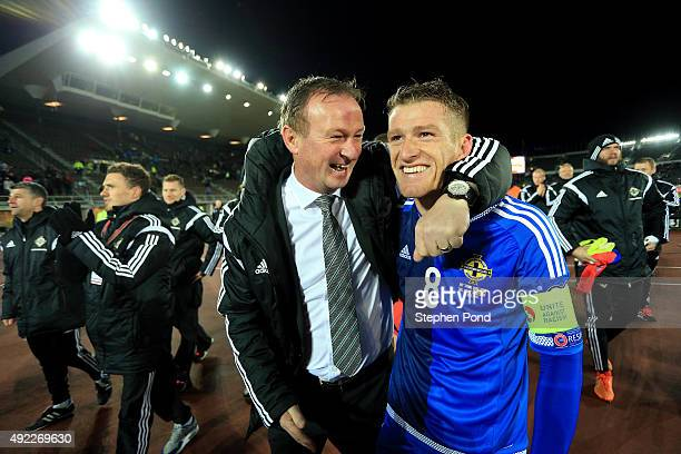 Northern Ireland Manager Michael O'Neill and Captain Steven Davis celebrate after the UEFA EURO 2016 Qualifying match between Finland and Northern...