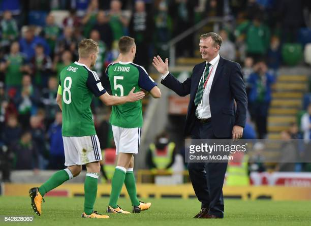 Northern Ireland manager Michael O'Neill celebrates with Steve Davis after the FIFA 2018 World Cup Qualifier between Northern Ireland and Czech...