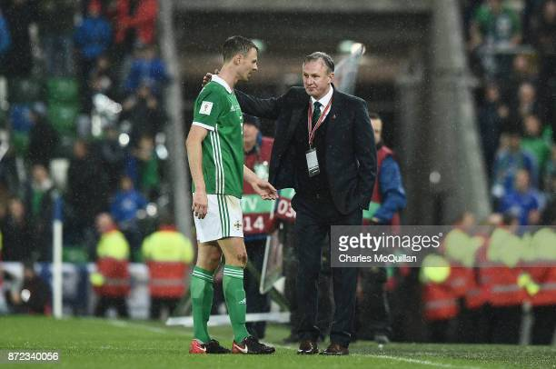 Northern Ireland manager Michael O'Neill consoles Jonny Evans after the FIFA 2018 World Cup Qualifier PlayOff first leg between Northern Ireland and...