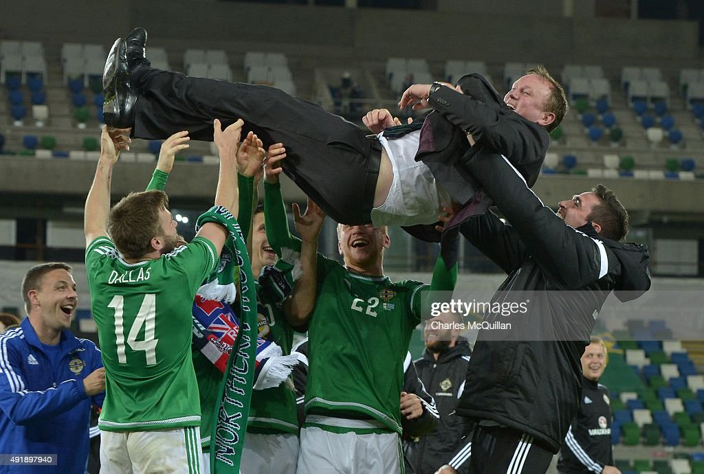 Northern Ireland manager Michael O'Neill is thrown in to the air by his players as they celebrate clinching qualification after this evenings Euro 2016 Group F international football match against Greece at Windsor Park on October 8, 2015 in Belfast, Northern Ireland.