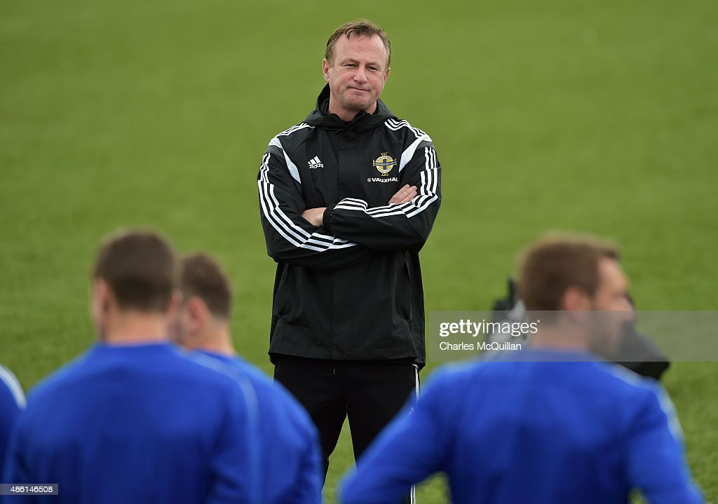 Northern Ireland manager Michael O'Neill watches on as the international football squad trains on Bangor F.C's plastic pitch on September 1, 2015 in Bangor, Northern Ireland. Northern Ireland travel to face the Faroe Islands in a Euro 2016 Group F qualifiying game in Torshavn on Friday evening.