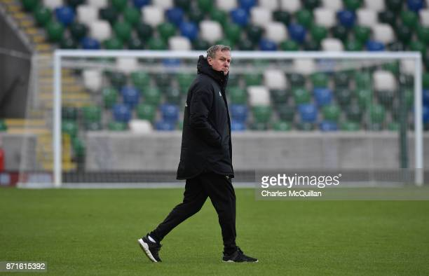 Northern Ireland manager Michael O'Neill watches on during the squad training session at Windsor Park on November 8 2017 in Belfast Northern Ireland...