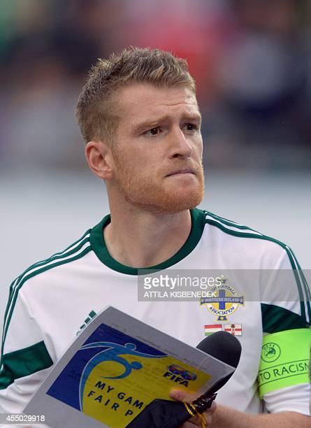 Northern Ireland midfielder and captain Steven Davis listens to his national anthem prior to the UEFA Euro 2016 Group F qualifying football match of...