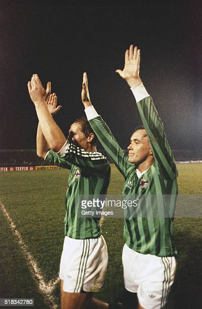 Northern Ireland players Billy Hamilton and Sammy McIlroy applaud the fans after a 1984 UEFA European Championship qualifier match against Austria at...
