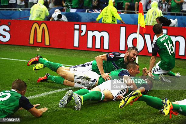 Northern Ireland players celebrate their first goal by Gareth McAuley during the UEFA EURO 2016 Group C match between Ukraine and Northern Ireland at...