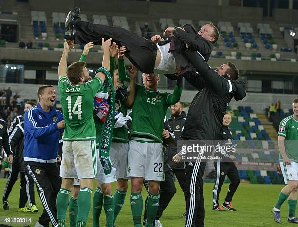 Northern Ireland players celebrate with manager Michael O'Neill after clinching qualification after this evenings Euro 2016 Group F international...