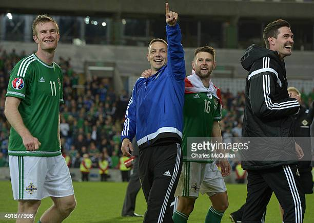 Northern Ireland players Chris Brunt Chris Baird Oliver Norwood and Kyle Lafferty celebrate clinching qualification after the UEFA EURO 2016...