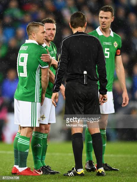 Northern Ireland players contest the referees decision after he awards a penalty to Switzerland during the FIFA 2018 World Cup Qualifier PlayOff...