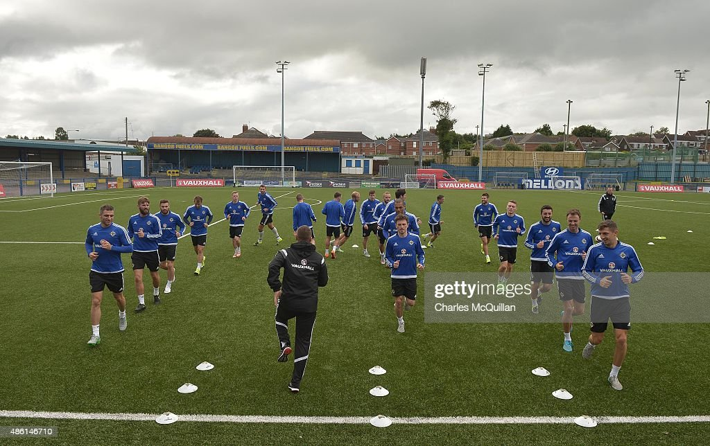 Northern Ireland players limber up as the international football squad train on Bangor F.C's plastic pitch on September 1, 2015 in Bangor, Northern Ireland. Northern Ireland travel to face the Faroe Islands in a Euro 2016 Group F qualifiying game in Torshavn on Friday evening.