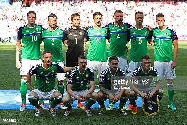 Northern Ireland players line up for the team photos prior to the UEFA EURO 2016 Group C match between Poland and Northern Ireland at Allianz Riviera...