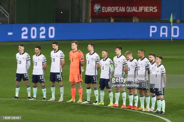 Northern Ireland players line up to observe a minute's silence in memory of former Italian National team members Pietro Anastasi, Pierino Prati,...