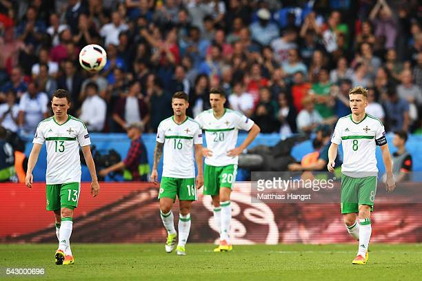 Northern Ireland players show their dejection after Wales' first goal during the UEFA EURO 2016 round of 16 match between Wales and Northern Ireland...