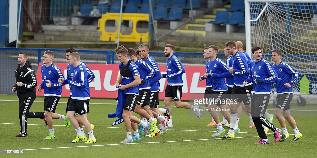 Northern Ireland players take part in a training exercise as the international football squad train on Bangor F.C's plastic pitch on September 1, 2015 in Bangor, Northern Ireland. Northern Ireland travel to face the Faroe Islands in a Euro 2016 Group F qualifiying game in Torshavn on Friday evening.
