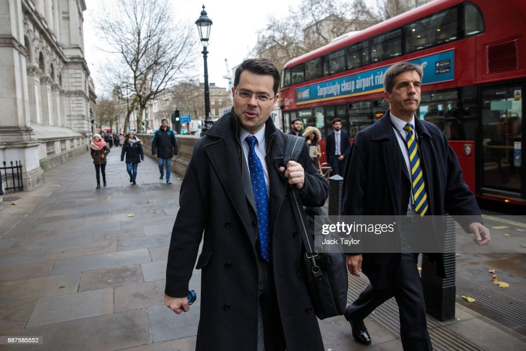 Northern Ireland Secretary James Brokenshire (C) walks down Whitehall on December 7, 2017 in London, England. The British Government continues to work out a deal on the matter of the Ireland border before Brexit negotiations with the EU can continue.